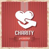 stock photo of slogan  - Charity with Heart in Hand and slogan on ribbon on Red Striped Background - JPG