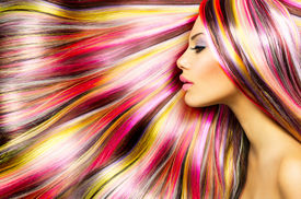stock photo of hair dye  - Beauty Fashion Model Girl with Colorful Dyed Hair - JPG