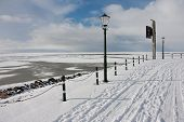 foto of gare  - View from Dutch promenade of Urk at the frozen sea in wintertime - JPG