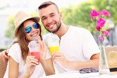 pic of lost love  - A picture of a happy couple drinking smoothies in an outside cafe - JPG