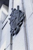 picture of hammer sickle  - Star hammer and sickle symbols of USSR on facade of grey house