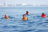picture of pro-life  - people in life jackets swimming in open sea - JPG