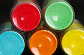 image of pigment  - Bottles with colorful dry pigments on dark background - JPG