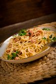 image of carbonara  - Delicious spaghetti with bacon and egg called alla carbonara on wooden table - JPG