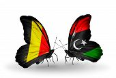 pic of libya  - Two butterflies with flags on wings as symbol of relations Belgium and Libya - JPG