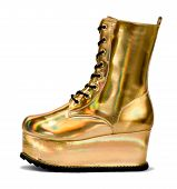 stock photo of platform shoes  - Golden alien shoe with a shiny metallic finish in the form of an ankle boot with high platform sole for trendy modern ladies fashion side view on white - JPG