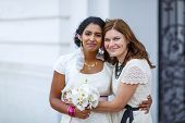 stock photo of indian wedding  - Beautiful happy indian bride and her girl friend as bridesmaid after wedding ceremony - JPG