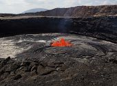 stock photo of magma  - Lava burst inside the Erta Ale volcano - JPG