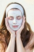 image of cleanse  - Nourishing Hydrating cleansing mask on the face of the girl - JPG