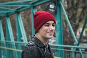 image of anarchists  - Punk guy with beanie posing in the city streets - JPG