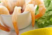 image of romaine lettuce  - fresh shrimp cocktail with sauce lemon wedges and garnished with crispy romaine lettuce - JPG