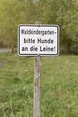 image of hayfield  - german sign on wooden pole - JPG