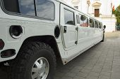 picture of limousine  - long white wedding limousine waiting for newlywed - JPG