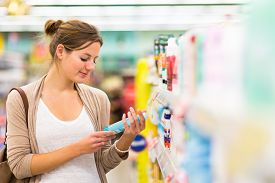 picture of grocery cart  - Beautiful young woman shopping in a grocery store - JPG