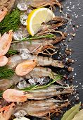 picture of tiger prawn  - Fresh prawns with spices on black stone background - JPG