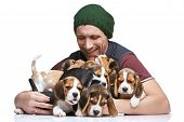 image of puppy beagle  - The happy man and big group of a beagle puppies on white background - JPG