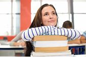 picture of thoughtfulness  - Thoughtful female student with books in the classroom - JPG