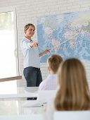 foto of geography  - Teacher in classroom teaching geography to pupils - JPG