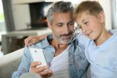 pic of daddy  - Daddy with son playing with smartphone - JPG