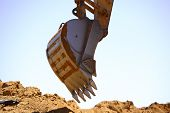 foto of excavator  - Close up view of a shovel of a excavator on a construction site - JPG