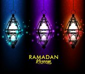 pic of kareem  - Beautiful Elegant Ramadan Kareem Lantern or Fanous Hanging With Colorful Lights in Night Background With Islamic or Arabic Pattern - JPG