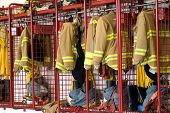 picture of firehouse  - fireman coats and boots wait for the next call - JPG