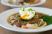 stock photo of egg noodles  - Udon noodles topped with meat - JPG