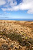 image of volcanic  - spain volcanic timanfaya rock stone sky hill and summer in los volcanes lanzarote - JPG