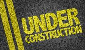 foto of road construction  - Under Construction written on the road - JPG