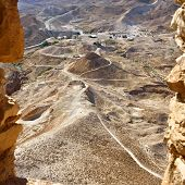stock photo of zealots  - View on siege embankment against the western face of the zealot fortress Masada built Legio X Fretensis during First Jewish - JPG