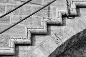 stock photo of bannister  - Abstract take of a staircase on an old stone wall - JPG