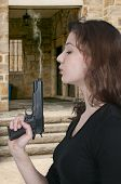 picture of handgun  - Beautiful woman with a loaded handgun pistol - JPG