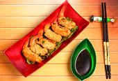 picture of deep  - traditional Vietnam deep fried shrimp and pork rolls in breadcrumbs served on a wood table top - JPG