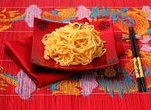 pic of carbonara  - spaghetti carbonara served on a bamboo place mat