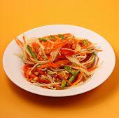 picture of papaya  - thai hot papaya salad with an orange background - JPG