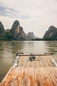 stock photo of raft  - Bamboo rafting li river from guilin to yangshuo china - JPG