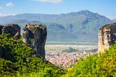 picture of red roof  - Aerial view of monastery at Meteora cliff in Greece and traditional greek Kalambaka town with red roofs - JPG