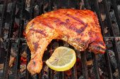 picture of bbq party  - BBQ Roasted Chicken Leg Quarter On The Hot Charcoal Grill Close - JPG