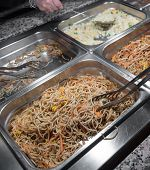 stock photo of buffet  - buffet of spaghetti and rice with vegetables in the Chinese restaurant - JPG