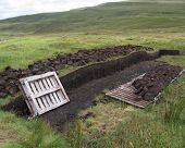 picture of boggy  - Blocks of peat which has been hand cut using traditional methods - JPG