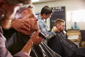 image of barber razor  - Male Barber Giving Client Shave In Shop - JPG
