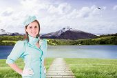 picture of air hostess  - Air hostess against scenic backdrop - JPG