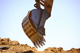 image of excavator  - Close up view of a shovel of a excavator on a construction site - JPG