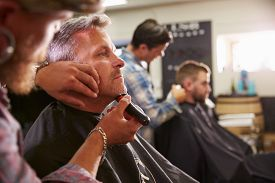 picture of barber razor  - Male Barber Giving Client Shave In Shop - JPG