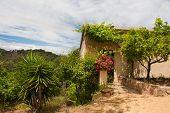 stock photo of hacienda  - Spanish hacienda house in the county in nature - JPG