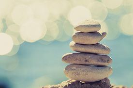 stock photo of stability  - Stones balance at the vintage beach inspirational summer landscape - JPG